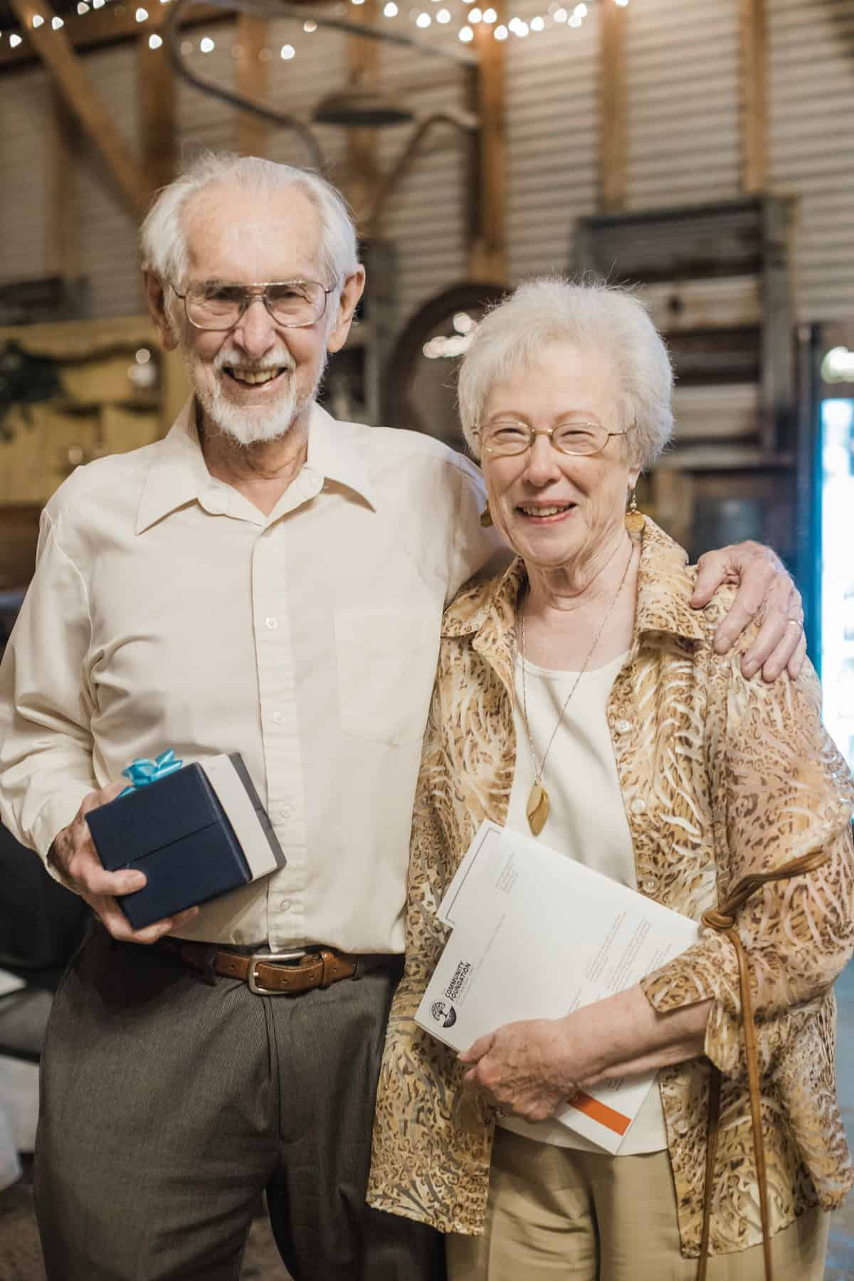 Drs. Norman and Nancy Eiss smiling with their awards